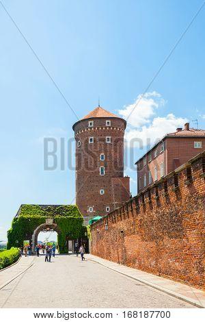 Poland, Krakow - June 09, 2016: Tourists Walking Near The Bernardine Gate And Medieval Sandomierska