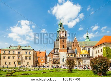 Krakow, Poland - June 08, 2016: Tourists Visiting Historical Complex Of Wawel Royal Castle And Cathe
