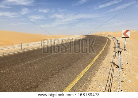 Desert road to the Moreeb Dune in Liwa Oasis area. Emirate of Abu Dhabi United Arab Emirates