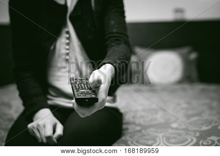 Girl In A Home Environment, Holding A Tv Remote, Switching Channels