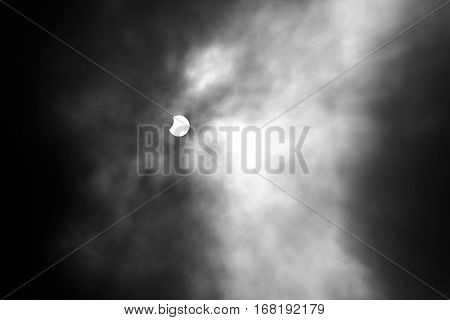 End and Partial Solar Eclipse on a Cloudy Day in Brussels on 20 march 2015
