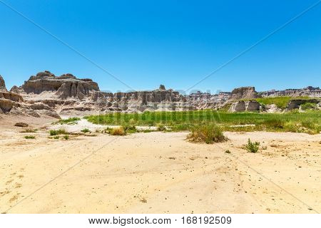 Landscape of the Badlands with green grass.