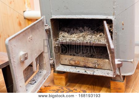 Solid bio fuel boiler in the boiler room with Burn wood coals of fire