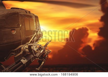 Military helicopter flying on sunset background.