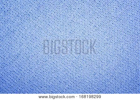 Blue structure of a knitted woolen fabric background