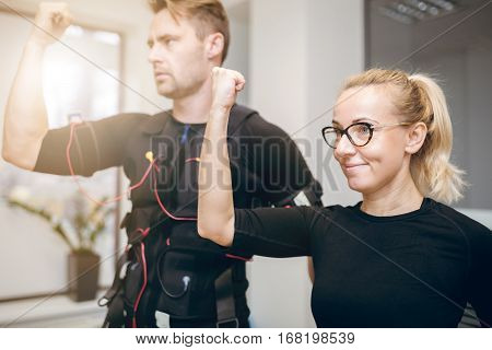 Happy Woman Training At Gym With Sportsman