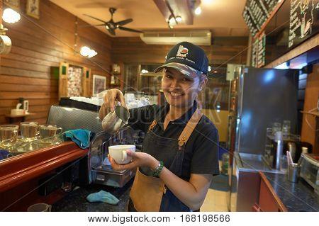 PATTAYA, THAILAND - CIRCA FEBRUARY, 2016: barista at Coffee Mania coffee shop in Pattaya.
