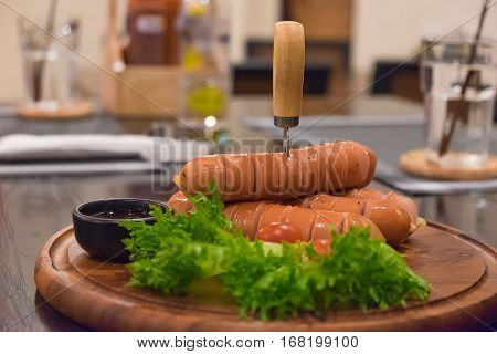 Fried Sausages With Vegetable In Wood Plate. On The Wooden Table.