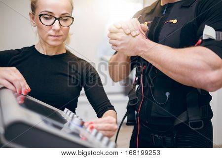 Trainer Setting Up Ems Device