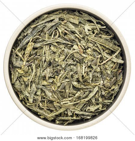 loose leaf sencha green tea in a ceramic round  bowl isolated on white