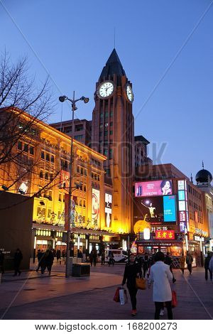 BEIJING - FEBRUARY 23: Clock tower on Wangfujing street in Beijing. Wangfujing one of the most famous shopping street in Beijing, is very popular among tourists and locals, February 23, 2016.
