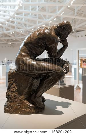 MEXICO CITY,MEXICO - DECEMBER 25,2016 : The Thinker by Auguste Rodin at the Soumaya museum of art in Mexico City