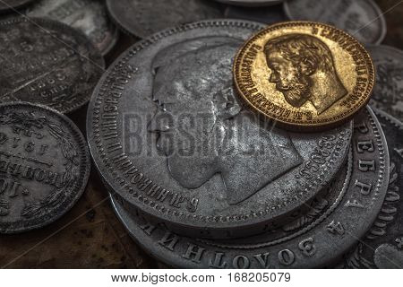 Old coins from silver and gold carry from a shadow of last centuries of the person and feeling of old times