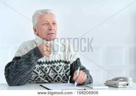 senior man at office on coffe break
