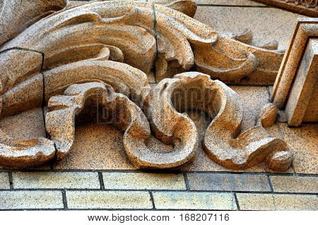 Background image of scalloped stonework on historic train depot in Livingston Montana.