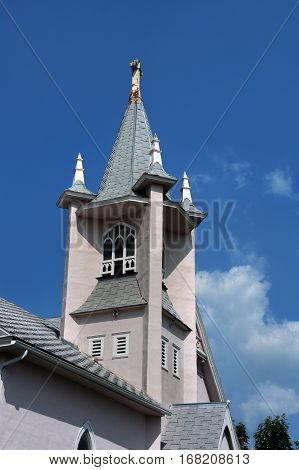 St. Mark's Church in Livingston Montana has cupola tower with cross topper.