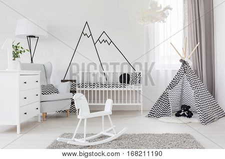 Room With Cockhorse And Crib