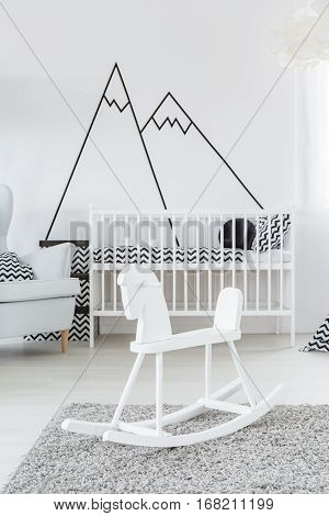Cockhorse in baby room with scandinavian crib