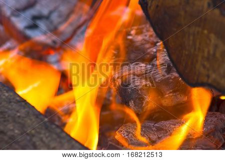 big red burning logs at fire place