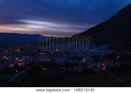 Night sky over Chefchaouen the blue city in Morocco, Africa