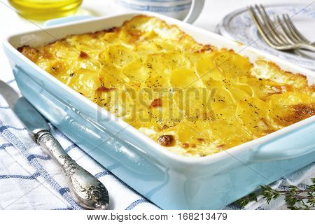Potato Gratin In A Blue Baking Dish.vintage Style.