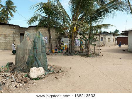 ZANZIBAR, TANZANIYA- JULY 13: simple street in african village on July 13, 2016 in Zanzibar