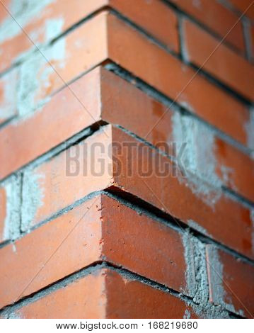 corner of the brickwork with sticking brick closeup