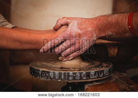 Pottery artist handmade. Closeup Hands making pottery