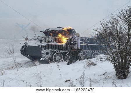 LENINGRAD REGION, RUSSIA - JANUARY 15, 2017: Padded German tank PzKpfw II Ausf D and fleeing German soldiers. Fragment of reconstruction of battles of the great Patriotic war. Operation