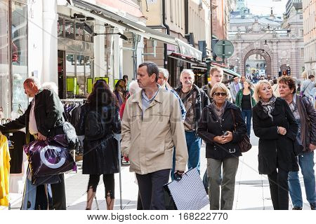 Tourists On Drotninggatan Street In Stockholm City