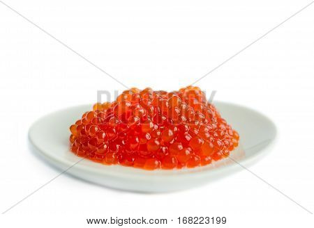 Red caviar on a platte, isolated on white background, close up