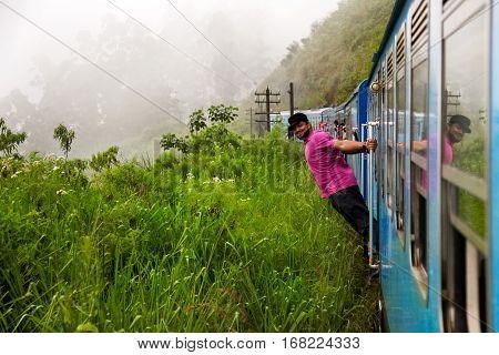Sri Lanka Nuwara Eliya - October 2015: People traveling by train in the mountains of Sri Lanka. Surroundings Nuwara Eliya.