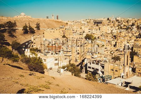 Photo of the Amman city view with Umayyad Palace on background. Urban landscape. Residential area. Arabic architecture. Eastern city. Housing estate