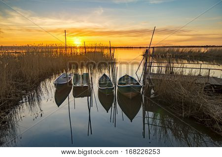 fishing boats in a quiet bay on the lake sunset
