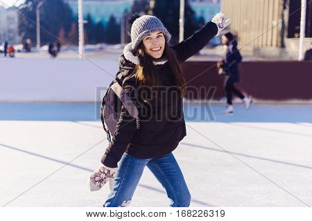 Beautiful Young Woman Wearing Warm Winter Clothes On Ice Skating In Winter