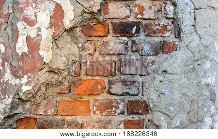 Vintage brick rough rustic wall with damaged plaster. Grunge Red white stonewall background.
