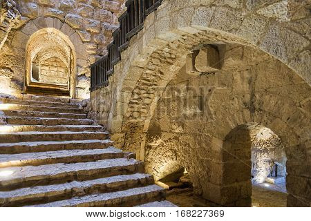 Ajloun, Jordan - April 04, 2015: View of Ajloun Castle main entrance and staircase. Ajloun Castle is situated in northwestern Jordan on a hilltop, was built in the 12th century and is open for tourism