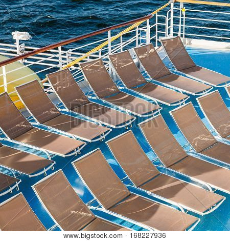 above view of empty chairs in sunbathing area on stern of cruise liner
