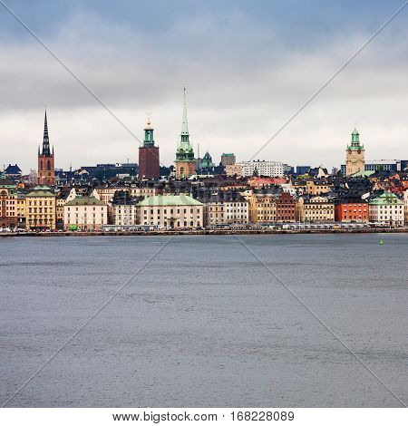 front view of center of Stockholm city (Galma Stan) from sea in cloudy autumn day