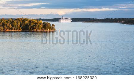 view of cruise liner and coastline of Baltic Sea in autumn sunset Sweden