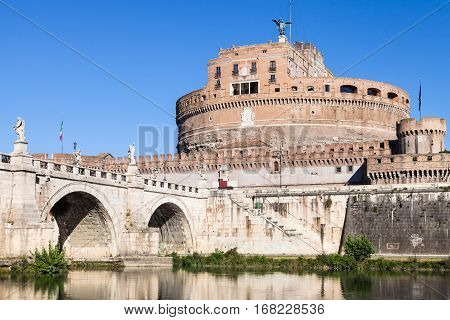 travel to Italy - exterior of Castel Sant Angelo (Castle of the Holy Angel Mausoleum of Hadrian) and bridge of St Angel in Rome city from Tiber river in sunny day