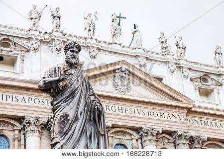travel to Italy - Statue Saint Peter and St Peter's Basilica on background on piazza San Pietro in Vatican city