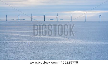 Travel to Denmark - panorama of Baltic Sea with offshore wind farm Middelgrunden in Oresund near Copenhagen city in blue autumn morning
