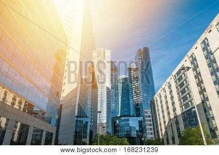 Skyscrapers at sunset with sunlight in the blue sky