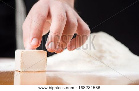 Male Hand Reaching Yeast Cube On Baking Table