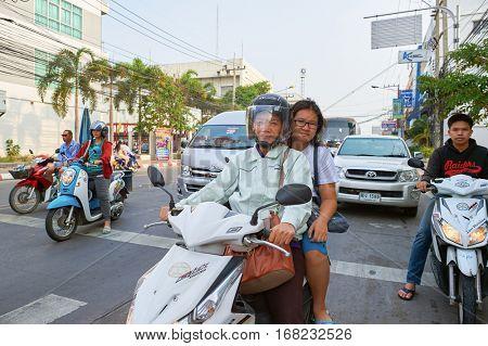 PATTAYA, THAILAND - CIRCA FEBRUARY, 2016: woman drives motorbike in Pattaya at daytime. Pattaya is a resort city in Thailand.
