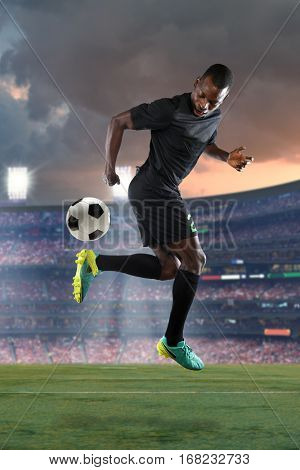 African American soccer player performing back kick inside stadium