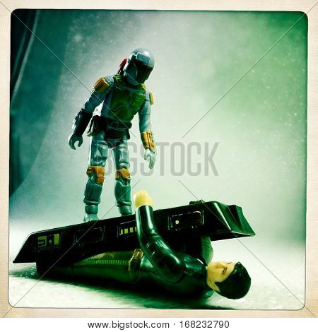 Vintage Kenner Star Wars action figures Boba Fett standing on top of Han Solo crushing him with a carbonite chamber - filtered image