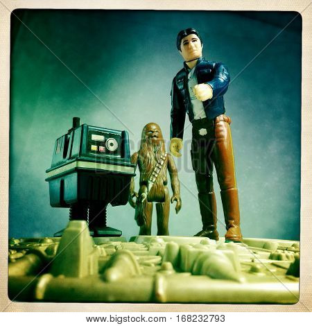 Vintage Kenner Star Wars figures Han Solo, Chewbacca the Wookiee and a GNK Gonk Power Droid atop the Millennium Falcon, recreating a scene on Hoth from The Empire Strikes Back  - filtered image
