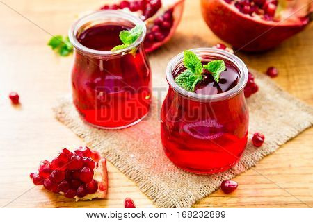 Pomegranate Liqueur, Pomegranate Juice. Old Wooden Background, Selective Focus